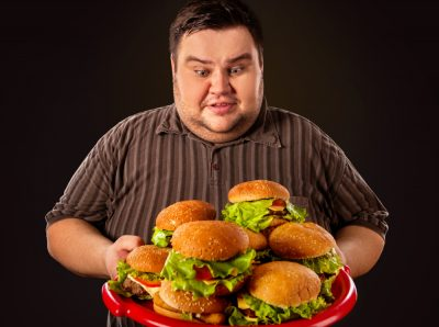 fat man plateful of burgers
