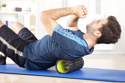back exercise using a foam roller